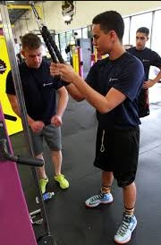 working out at planet fitness