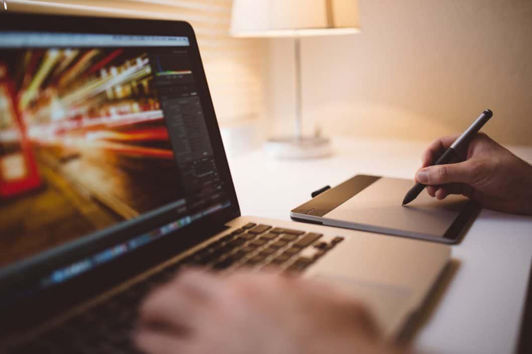 Graphics artist using laptop