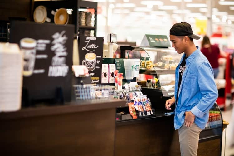 man standing in front cashier